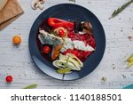 stew with fish and vegetables ... | Shutterstock . vector #1140188501