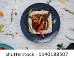 fried meat with rice in a plate | Shutterstock . vector #1140188507