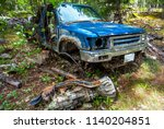 car wreck at lillooet lake at... | Shutterstock . vector #1140204851