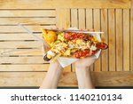 hands of a girl with a fork and ... | Shutterstock . vector #1140210134