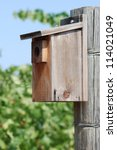 a wood birdhouse on a wood post ... | Shutterstock . vector #114021049