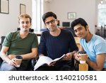 three relaxed students studying ... | Shutterstock . vector #1140210581