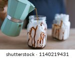 pouring coffee in the glass and ...   Shutterstock . vector #1140219431