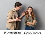 unhappy young couple having an... | Shutterstock . vector #1140246401