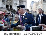 Small photo of Belgium's King Philippe greets the crowd after a religious service (Te Deum) at the Sainte-Gudule cathedral on Belgian national day in Brussels, Belgium July 21, 2018.