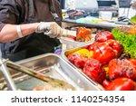 close up female seller hands... | Shutterstock . vector #1140254354