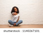young black woman sitting on a... | Shutterstock . vector #1140267101