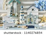 home decoration with souvenirs... | Shutterstock . vector #1140276854