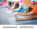 people practicing yoga at... | Shutterstock . vector #1140292511