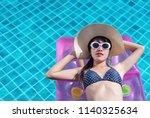 woman asian bikini swimming...   Shutterstock . vector #1140325634