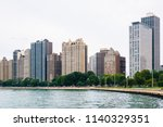 lake michigan and buildings in... | Shutterstock . vector #1140329351