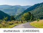 a road and view of mountains in ...   Shutterstock . vector #1140330641