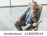 high angle view of handsome... | Shutterstock . vector #1140339614