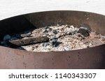 embers in circular iron brazier ... | Shutterstock . vector #1140343307