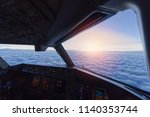 sky view from airplane inside... | Shutterstock . vector #1140353744