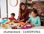 children helping mother to make ... | Shutterstock . vector #1140391961