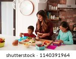children helping mother to make ... | Shutterstock . vector #1140391964