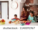 children helping mother to make ... | Shutterstock . vector #1140391967