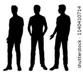 vector silhouettes men standing ... | Shutterstock .eps vector #1140410714