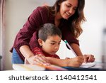 mother helping son with... | Shutterstock . vector #1140412541