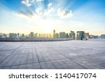 empty square with city skyline... | Shutterstock . vector #1140417074