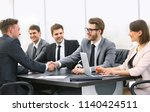 handshake of a manager and a... | Shutterstock . vector #1140424511