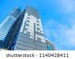 skyscrapers in financial... | Shutterstock . vector #1140428411