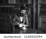 bearded man in elegant suit.... | Shutterstock . vector #1140433394