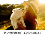 Girl Holding A Dog Breed Of Th...