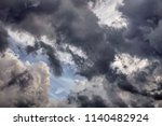 ragged clouds in shadow seem to ... | Shutterstock . vector #1140482924