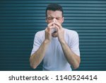 guy in white shirt is suffering.... | Shutterstock . vector #1140524414