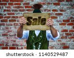bavarian man in front of brick... | Shutterstock . vector #1140529487