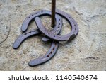 Stock photo three rusty horseshoes on the ground playing in the fresh air 1140540674