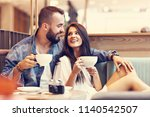 romantic couple dating in cafe   Shutterstock . vector #1140542507