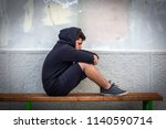 little boy sad sitting alone at ... | Shutterstock . vector #1140590714