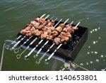 preparation of a shish kebab on ... | Shutterstock . vector #1140653801