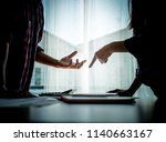 silhouette asian couple is... | Shutterstock . vector #1140663167