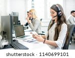 smiling customer support agent... | Shutterstock . vector #1140699101