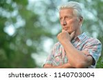 portrait of thoughtful senior... | Shutterstock . vector #1140703004