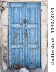 A Weathered Blue Door On The...