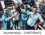 smiling young men drinking beer ...   Shutterstock . vector #1140740651