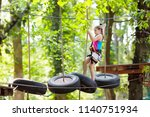 child in forest adventure park. ... | Shutterstock . vector #1140751934