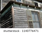 an abandoned house sits...   Shutterstock . vector #1140776471