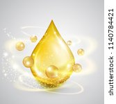 falling drop of golden oil with ... | Shutterstock .eps vector #1140784421