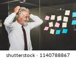 senior business man feeling... | Shutterstock . vector #1140788867