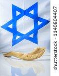 shofar horn on israel flag.... | Shutterstock . vector #1140804407