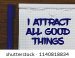 writing note showing i attract... | Shutterstock . vector #1140818834