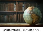 old globe on bookshelf... | Shutterstock . vector #1140854771