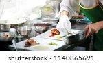 chef in the kitchen prepares... | Shutterstock . vector #1140865691