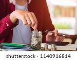 saving money concept asian man... | Shutterstock . vector #1140916814